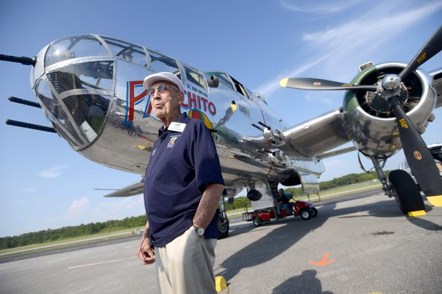 Associated Press/Northwest Florida Daily News, Nick Tomecek - Doolittle Raider Lt. Col. Dick Cole, stands in front of a B-25 at the Destin Airport in Destin, Fla. on Tuesday April 16, 2013 before a flight as part of the Doolittle Raider 71st Anniversary Reunion. Cole was Lt. Col. Jimmy Doolittle's co-pilot during the raid. The Doolittle Tokyo Raid was a notable attack on the Japanese during World War II using B-25's. The B-25 pilots trained to take off from an aircraft carrier, which the plane was not designed to do. (AP Photo/Northwest Florida Daily News, Nick Tomecek)